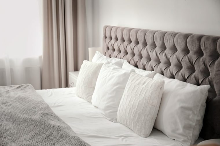 Pillows on bed in hotel room