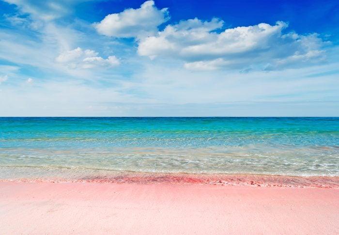 beautiful pink beach under a dramatic sky