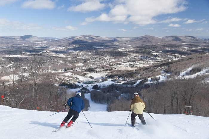 Overlooking the valley with skiers going downhill, Windham, New York, USA