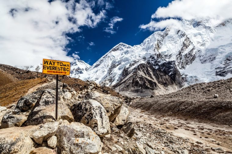 Footpath to Mount Everest Base Camp signpost in Himalayas, Nepal. Khumbu glacier and valley snow on mountain peaks, beautiful view landscape