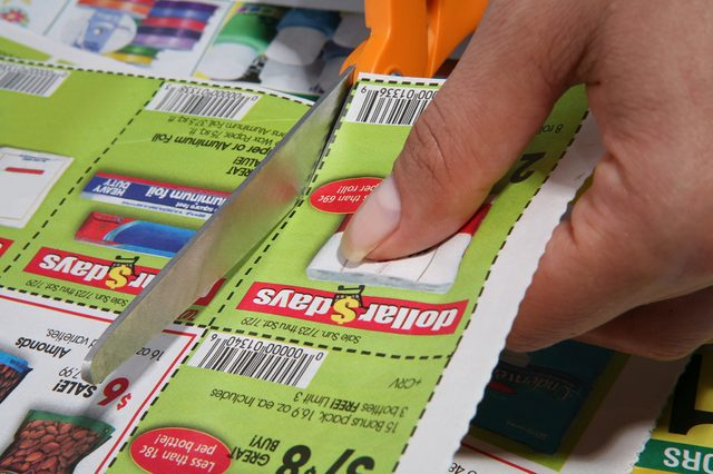 A woman cutting coupons