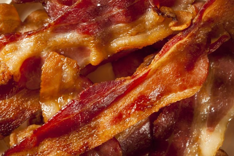 Crispy Organic Unhealthy Bacon on a Background