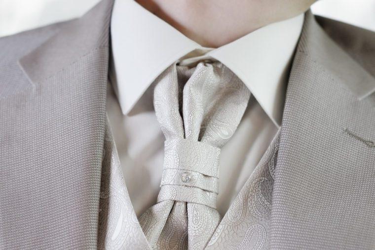 Elegant decoration on man wedding suit
