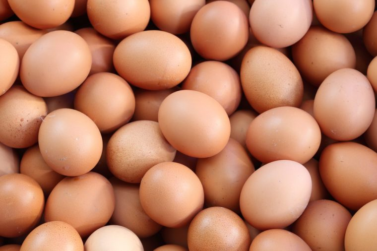 many fresh brown eggs for sale at a market