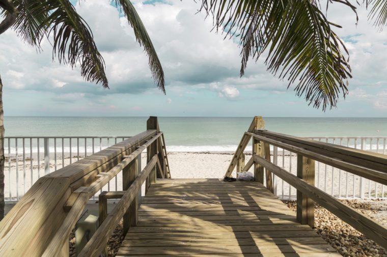 Wooden stairs on deserted beach dunes in Vero Beach, Florida