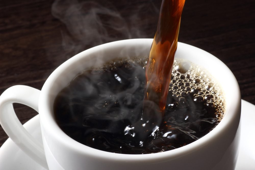 hot coffee pouring into a cup