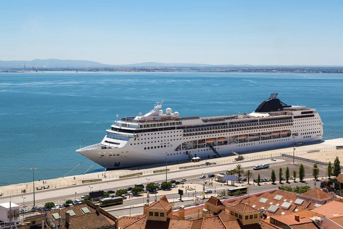 Big cruise ship is docked in Lisbon, Portugal in a beautiful summer day