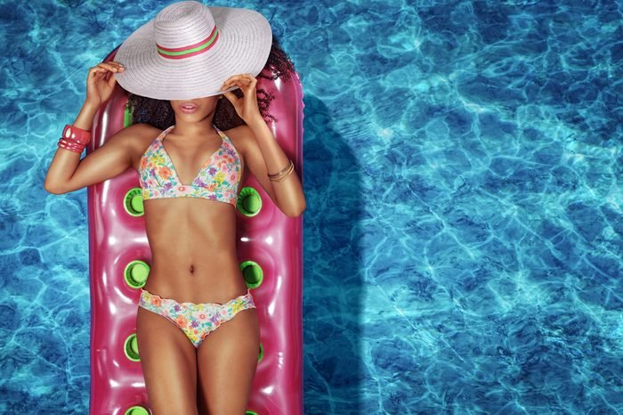 Vacation. Woman in a swimming pool