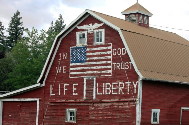 """Patriotic Red Barn with Painted American Flag and """"In God We Trust"""""""
