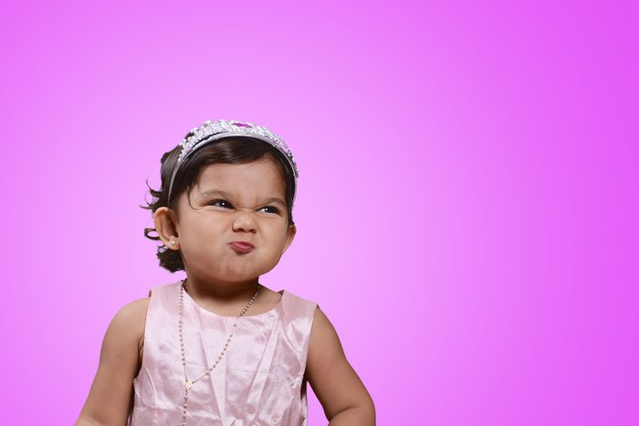 Beautiful baby on violet background