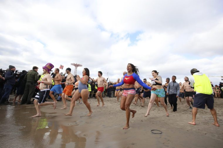 NEW YORK CITY - JANUARY 1 2016: Several hundred hardy New Yorkers plunged into the Atlantic waters off Coney Island in a tradition dating back to 1903.