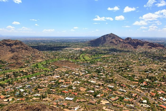 Aerial view of Paradise Valley and Camelback Mountain under Arizona's desert skies