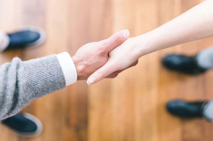 Business deal handshake from above. Straight focus on the hands