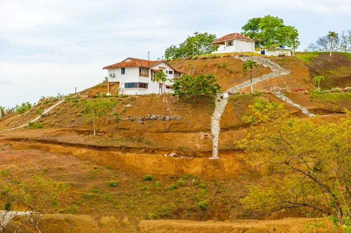 Houses on the hill in the countryside near Pedasi on Azuero peninsula in Panama, Central America.