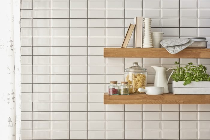 A collection of different ceramics complement a patterned tiles. For more inspiration. modern kitchenware new concept