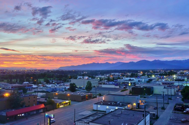 View of the Downtown Anchorage skyline in Alaska at sunset.