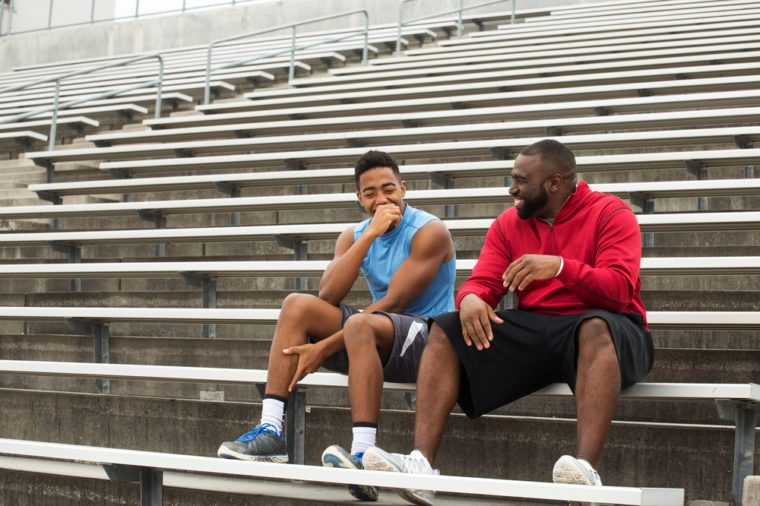 Coach spending time mentoring a student athlete.