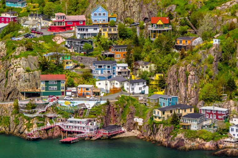 Aerial view of beautiful colorful houses built on the rocky slope of the Signal Hill in St. John's Newfoundland, Canada