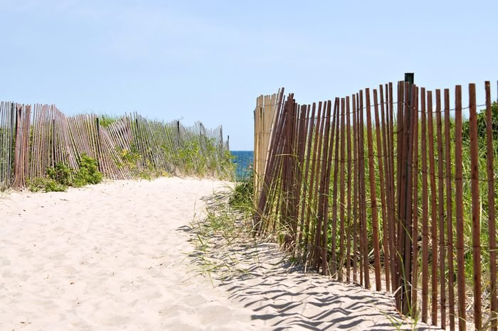 Wooden fences lining the entrance to the Rhode Island beach.