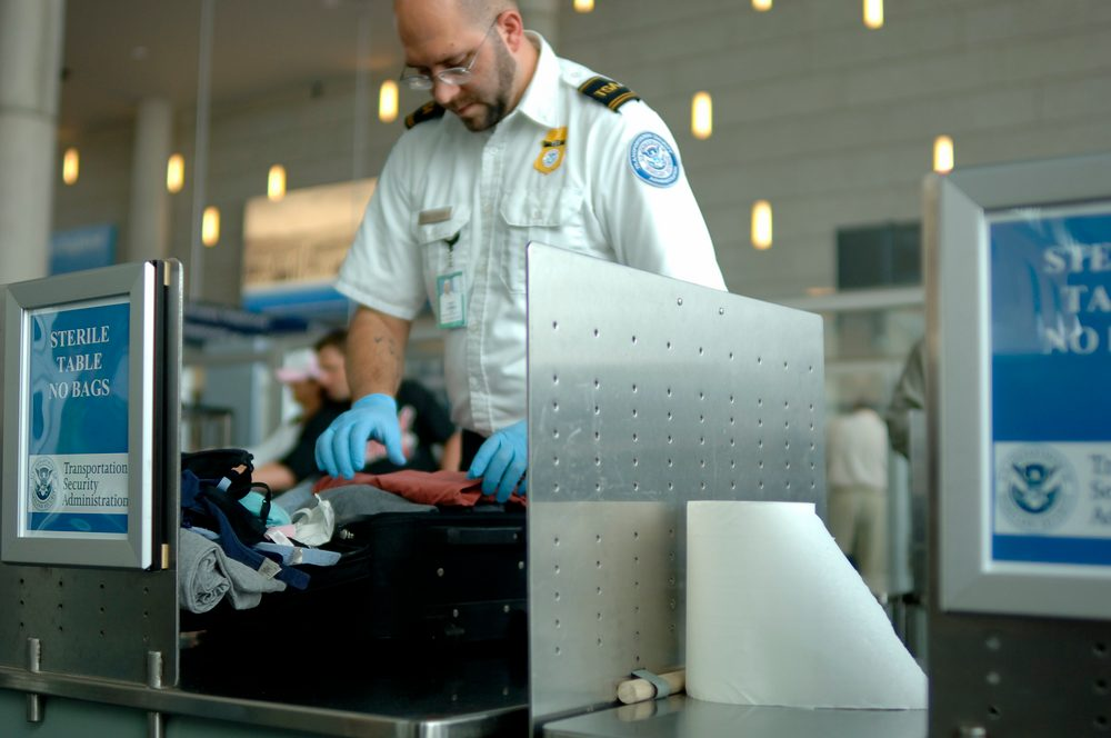 TSA agent searches bag