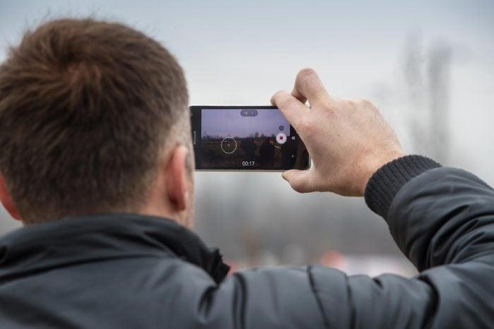 SVETA NEDELJA, CROATIA - NOVEMBER 27, 2016. 7th Rally Show Santa Domenica. Unidentified man taking video with smart phone.