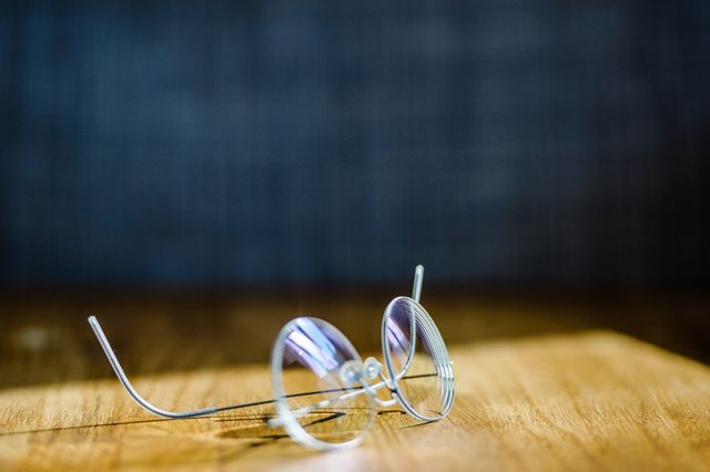 Elegant modern eyeglasses spectacles with thin titanium rim on office table