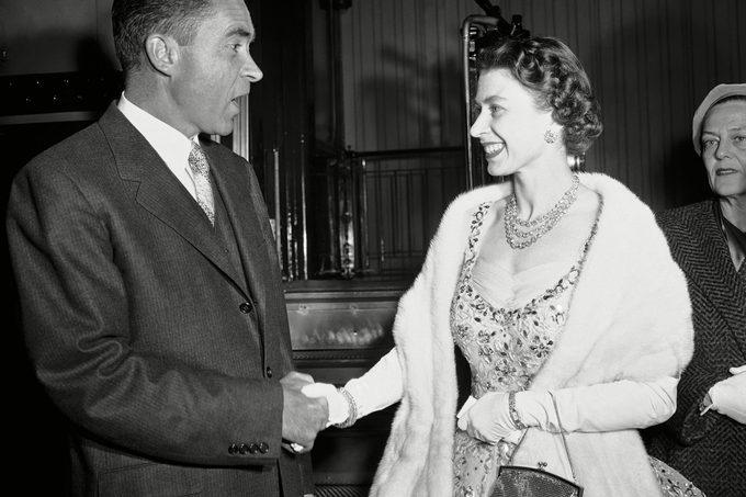 Queen Elizabeth II smiles, Vice President Richard Nixon