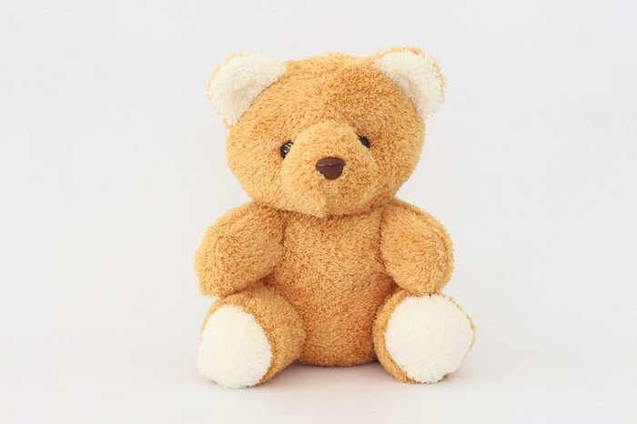 Teddy Bear looks cute on a white background.