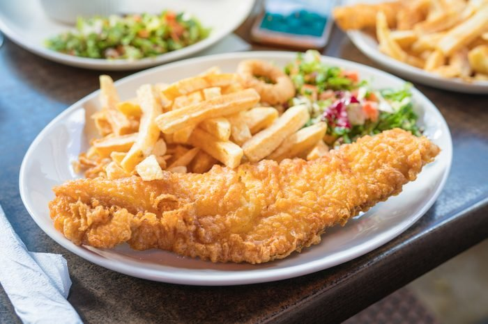 Fish and chips,Traditional British fish and chips,Fish and chips Fried fish fillet with french fries .