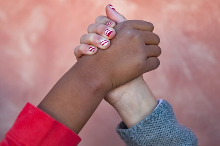 Hands of different races shaking