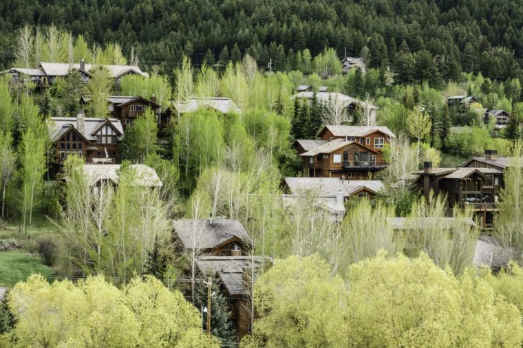 Upscale residential neighborhood in valley near base of mountain in Jackson, Wyoming, USA, in springtime