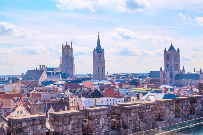 Aerial panoramic view of Ghent, Belgium with roofs and traditional medieval buildings, church tower