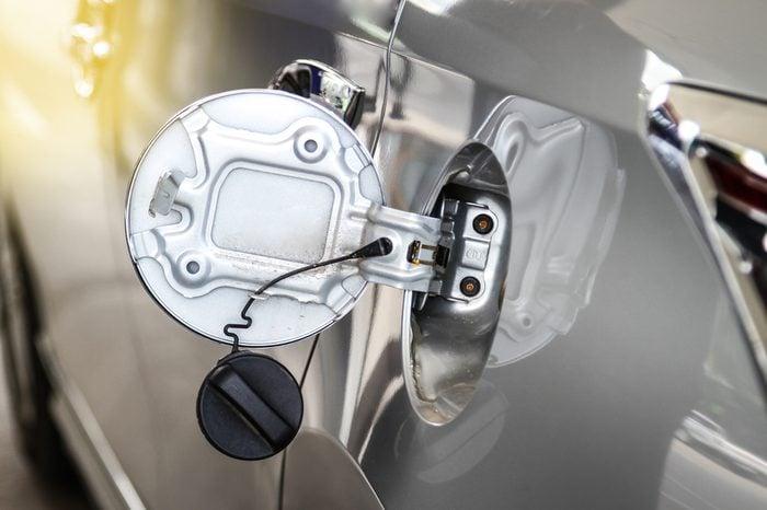 Silver automobile gas cap open.