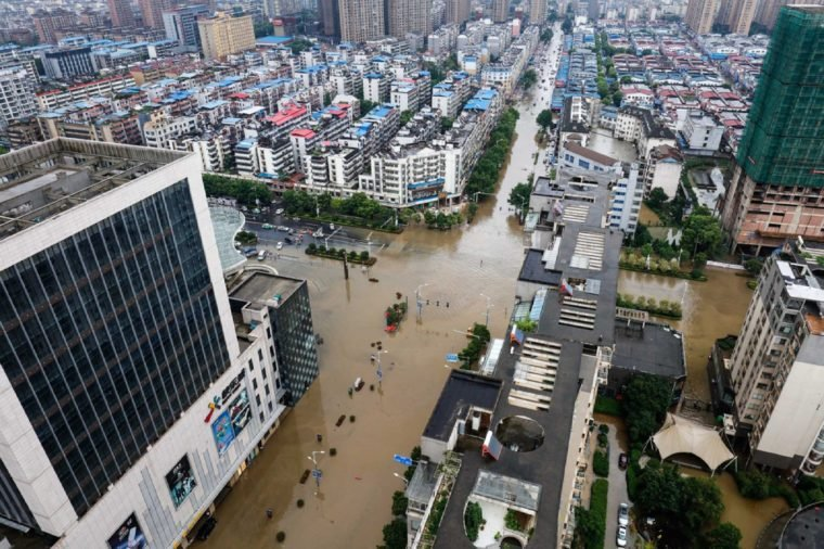 JIANGXI CHINA-July 1, 2017:Eastern China, Jiujiang was hit by heavy rain, and many urban areas were flooded. The vehicles were flooded, and the citizens risked their passage on flooded roads.