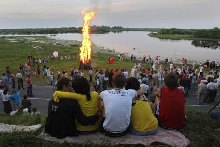 elarusians dance around a campfire on Ivan Kupala Day, an ancient night long celebration marking the Summer Solstice, the shortest night of the year, in the town of Turov