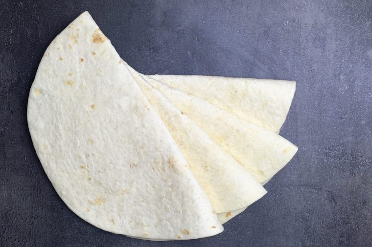 Tortilla wraps on black background. Top view.