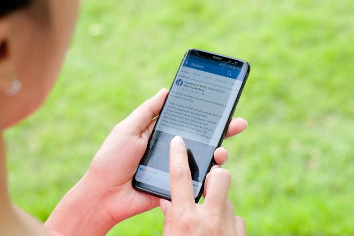 November 30, 2017 Bangkok, Thailand Women use mobile internet application facebook on smartphone Facebook is social networking service.