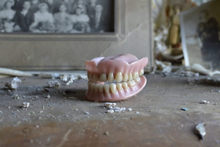 An old womans dentures found on a dresser in an old abandoned house