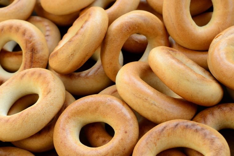 Close-up photo of fresh yellow bagels. A popular kind of flour products. One of the traditional Russian treats for tea