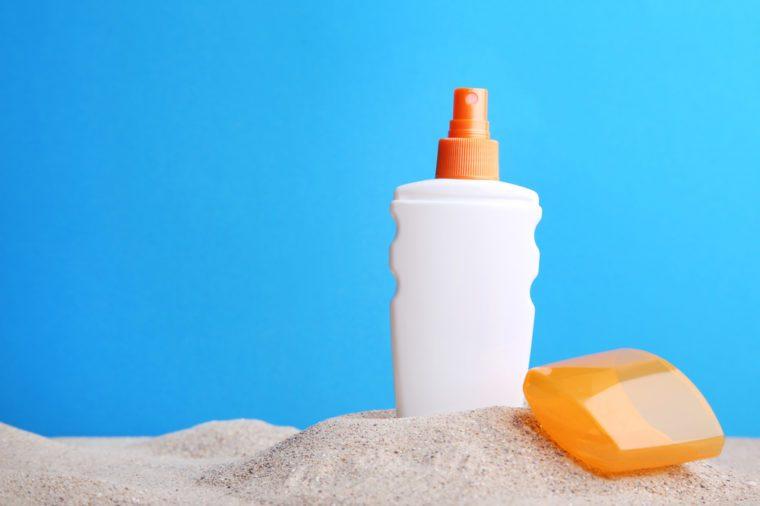 Sunscreen cream on beach sand
