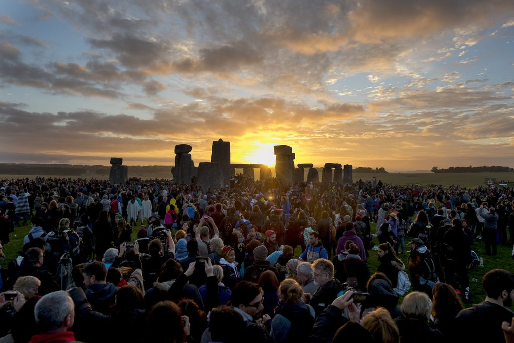 Sunrise. Summer solstice at the ancient stone circle at Stonehenge World Heritage site in Wiltshire.