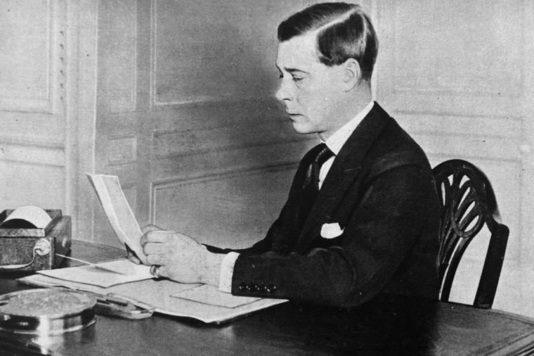 The Prince of Wales, later King Edward VIII studies papers at his office at St James's Palace, London.