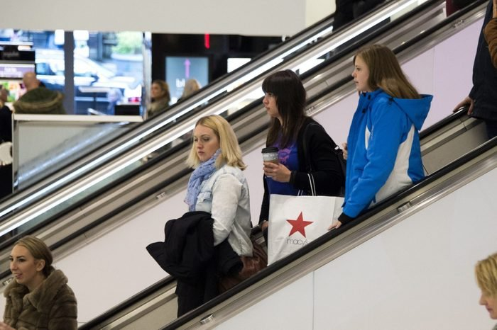 People Carry Shopping Bags at Macy's in New York