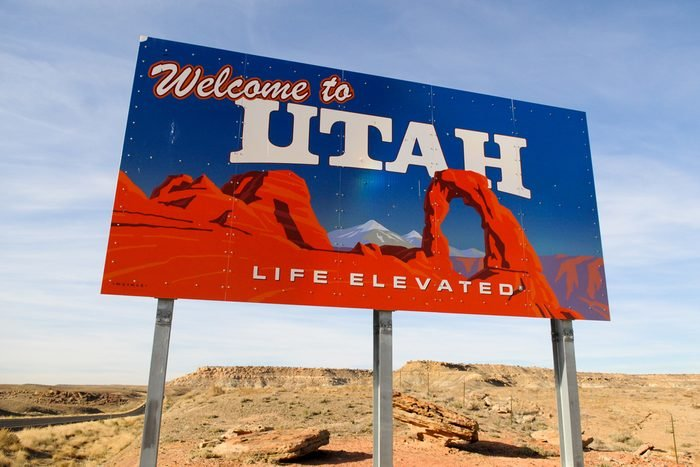 Welcome to Utah sign on a desolate desert highway