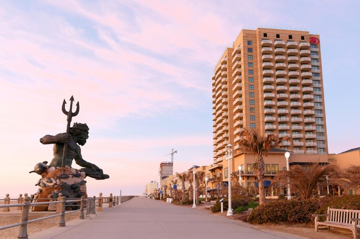 Virginia Beach, Virginia - April 2016: The Boardwalk of Virginia Beach at Sunrise. The Boardwalk is 28-feet wide and stretches three miles along the Virginia beach and is very popular for vacation.