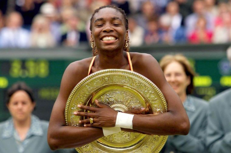 Wimbledon United Kingdom: Us Player Venus Williams Clutches Tight the Trophy After Winning the Womens Singles Final at the Wimbledon 2000 Tennis Tournament Against Compatriot Lindsay Davenport on Saturday 08 July 2000 Williams Won the Match in 6-3 7-6