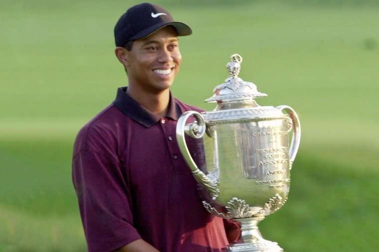 WOODS Tiger Woods holds up the Wanamaker Trophy after winning the PGA Championship over Bob May in a three-hole playoff, at the Valhalla Golf Club in Louisville, Ky