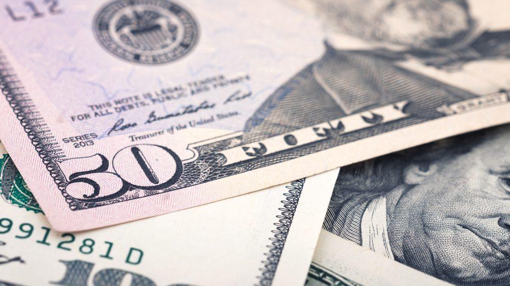 Closeup new American money fifty dollar bill. US 50 dollar banknote fragment macro.