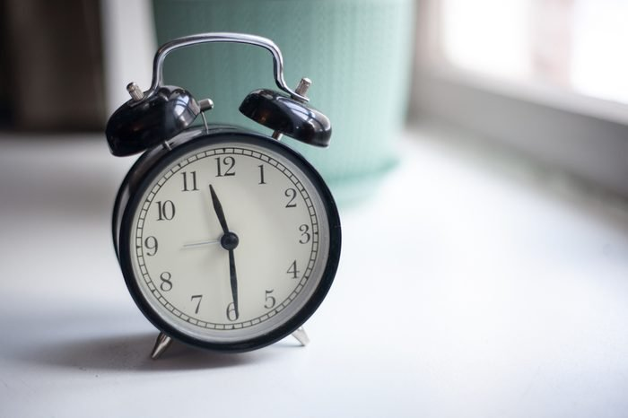clock on a beautiful background old time alarm clock wake up