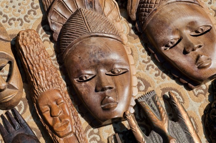 Wooden masks of African tribal on sale of flea market